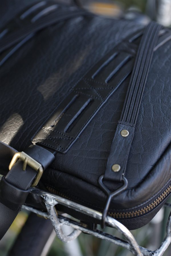 Oaks & Phoenix's bungee straps in black with black leather wrapped around a bag