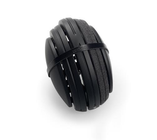 Product image of Brooks England bicycle helmet in black wrapped in a rubber band