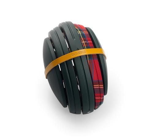 Product image of Brooks England bicycle helmet in black and red wrapped in a rubber band