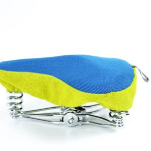 Side view product image of Undercover's saddle cover in blue and yellow