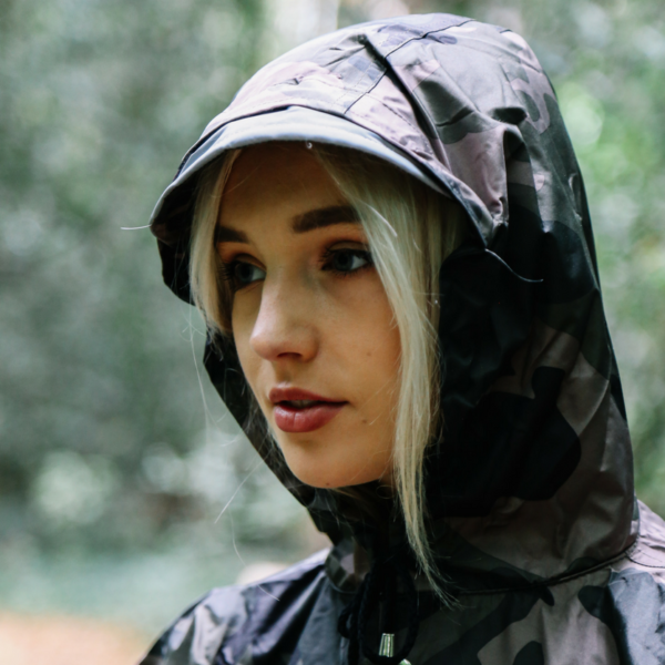 Close up of ¨A girl with The people's poncho in camoflage