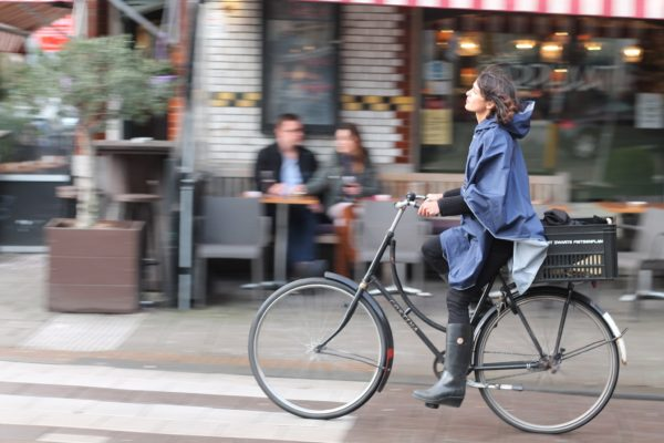 Woman rides a bike on the streets