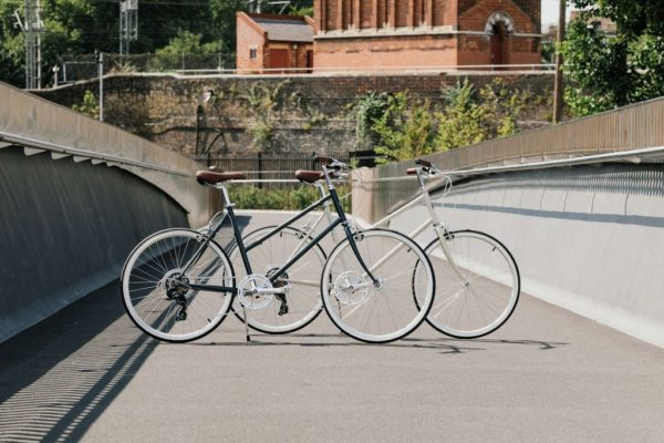 Two Tokyobike Bisou limited edition in the color Cool Grey and Off-White on a bridge