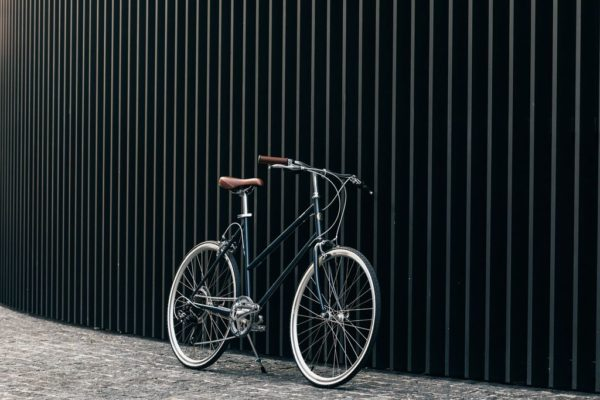 Tokyobike Bisou limited edition in the colorCool Grey against a black wall