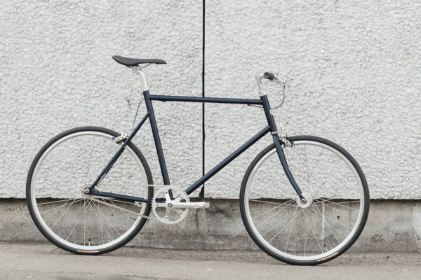 Tokyobike Single Speed standing against a grey wall